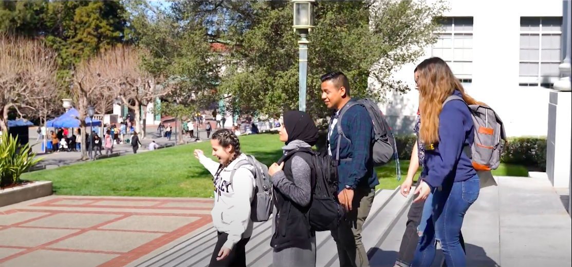 Marciela leading students to Sproul Hall