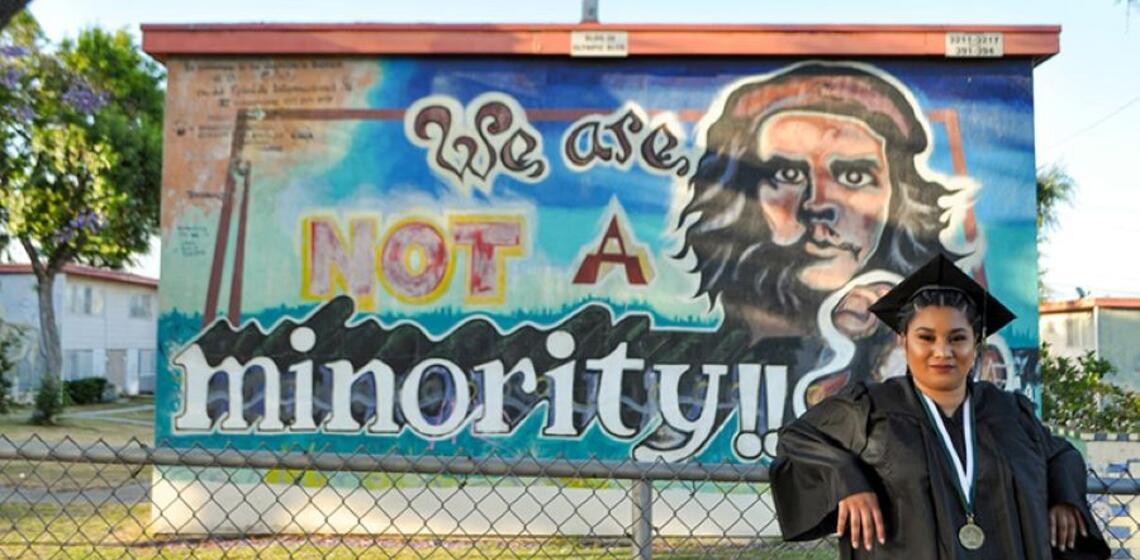 Kelly Figueroa in front of Mural